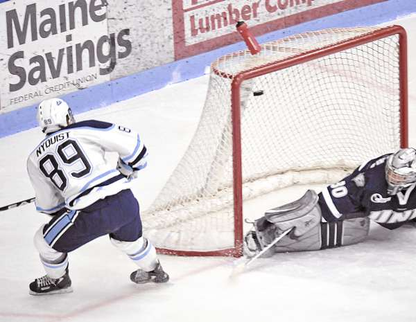 Maine's Gustav Nyquist (89) shoots high over the pad of New Hampshire goalie Matt DiGirolamo (30) for a goal in the second period of their game in Orono Friday, Dec. 10, 2010. Bangor Daily News/Michael C. York