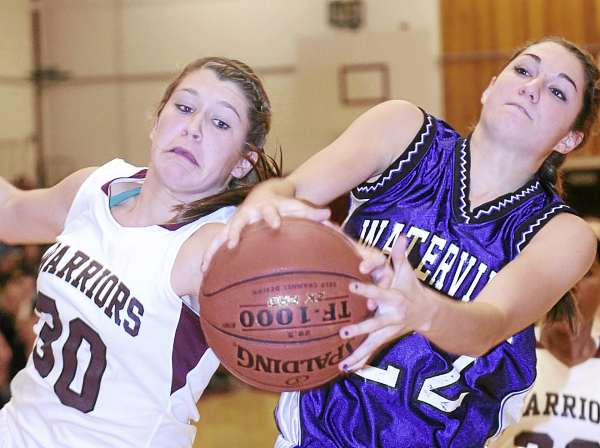 Nokomis' Anna Mackenzie (left) Waterville's Emily Karter battle for the ball during the first half of their game in Newport Friday night. Nokomis won 50-19. (Bangor Daily News Photo By Gabor Degre)