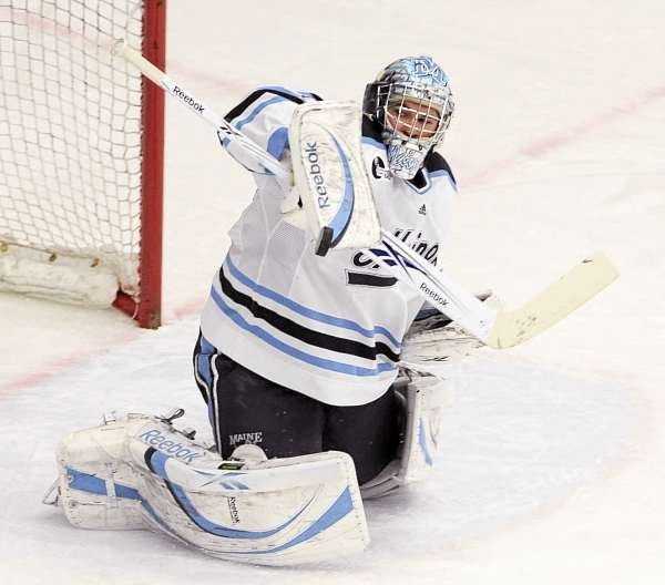 University of Maine goalie Dan Sullivan makes a save during the first period against the University of Massachusetts at Alfond Arena in Orono Sunday evening. Sullivan has been Maine's most consistent goaltender and has played the bulk of games. Sullivan is 5-3-1 with a 2.44 goals-against average. (BDN Photo by Gabor Degre)