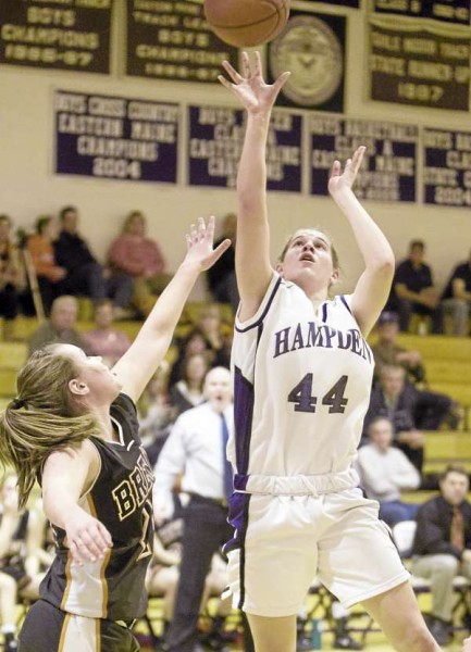 Julia Snyder of Hampden puts up a shot over Holly Nickerson of Brewer during a game held Dec. 14 at Hampden Academy.  Photo by: Monty J. Rand