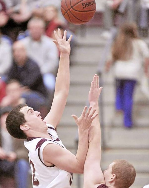 Ellsworth's Thomas sawyer (32) puts up a shot in the lane over GSA's Cameron Lawson in the first half of their game in Ellsworth Friday, Dec. 17, 2010. Bangor Daily News/Michael C. York