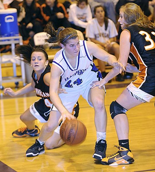 Hampden Academy's Julia Snyder (center) drives for the basket between Skowhegan's Megan Perkins (right) and Taylor Johnson during the first half of the game in Hampden Friday evening. Hampden won 58-48. (Bangor Daily News/Gabor Degre)