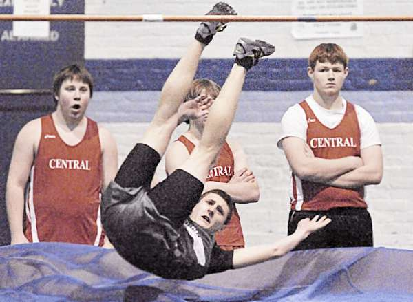 Old Town's Jake Leithiser looks up as he clears 6 feet, 3 inches in the high jump Saturday in Orono during an EMITL opening meet. Leithiser won the event. (Bangor Daily News/Michael C. York)