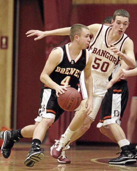 Brewer's Brad Billings drives past Bangor's Patrick Stewart during their game at on Tuesday, December 21, 2010 at Bangor High School. (Photo by Jason P. Smith)