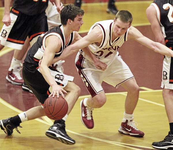 Bangor's Tristan Thomas defends against Brewer's Ray Bessette during their game at on Tuesday, December 21, 2010 at Bangor High School. (Photo by Jason P. Smith)
