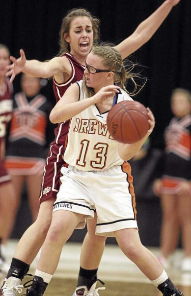 Brewer's Missy Thompson looks to pass around Bangor's Marissa Grandchamp during their game at Brewer High School on Tuesday, December 21, 2010. Bangor defeated Brewer 48-30. (Photo by Jason P. Smith)