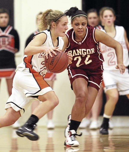 Brewer's Faith Thomas attempts to drive past Bangor's Deidre Johnson during their game at Brewer High School on Tuesday, December 21, 2010. Bangor defeated Brewer 48-30. (Photo by Jason P. Smith)
