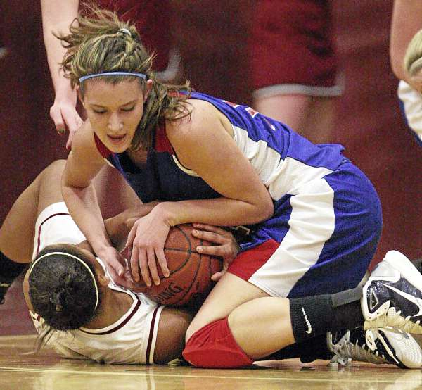 Bangor's Denae Johnson (bottom) and Messalonskee's Megan Pelletier struggle for possession of the ball during their girls basketball game at Bangor High School on Dec. 23, 2010. Messalonskee won 43-27.