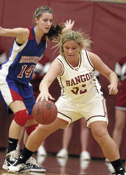 Bangor's Brianna McKenna (right) is defended by Messalonskee's Megan Pelletier during their Dec. 23, 2010, girls basketball game at Bangor High School. Messalonskee defeated Bangor 43-27.