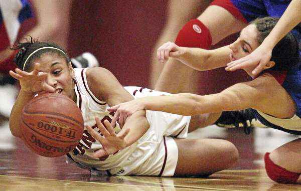 Bangor's Denae Johnson (left) and Messalonskee's Mary Badeen fight for a loose ball during their girls basketball game at Bangor High School on Dec. 23, 2010. Messalonskee of Oakland won 43-27.