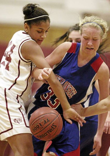 Bangor's Denae Johnson (left) and Messalonskee's Mikayla Turner fight for the ball during their girls basketball game at Bangor High School on Dec. 23, 2010. Messalonskee defeated Bangor 43-27.