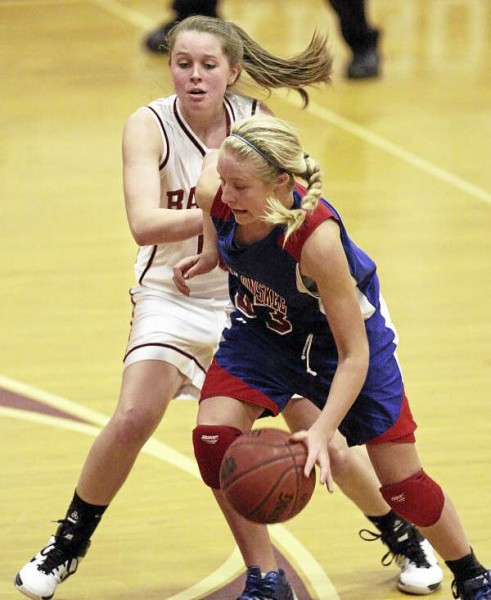 Messalonskee's Mikayla Turner drives past Bangor's Hillary Throckmorton during their girls basketball game at Bangor High School on Dec. 23, 2010. Messalonskee of Oakland won 43-27.
