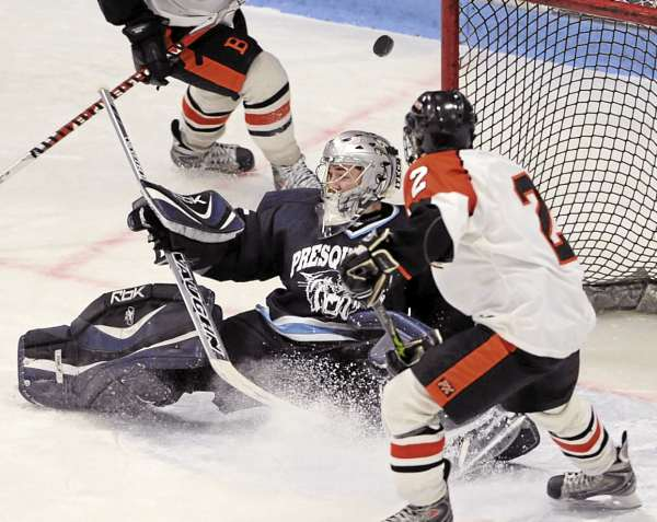 Presque Isle High School goalie Josh MacFarline makes a save off Jamie Williamson during the Eastern Maine Class B title game against Brewer at Alfond Arena in Orono on . MacFarline was an All-Eastern Maine Class B second team pick a year ago and is back to lead the Wildcats. Brewer is favored to defend its title, but Houlton-Hodgdon and Lawrence of Fairfield are considered the top threats to Brewer's supremacy.