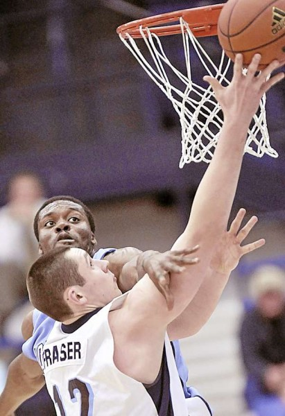 Maine's Alasdair Fraser (12) is fouled by Columbia's Asenso Ampim during a layup in the first half of their game in Orono Thursday, Dec. 30, 2010. Bangor Daily News/Michael C.York