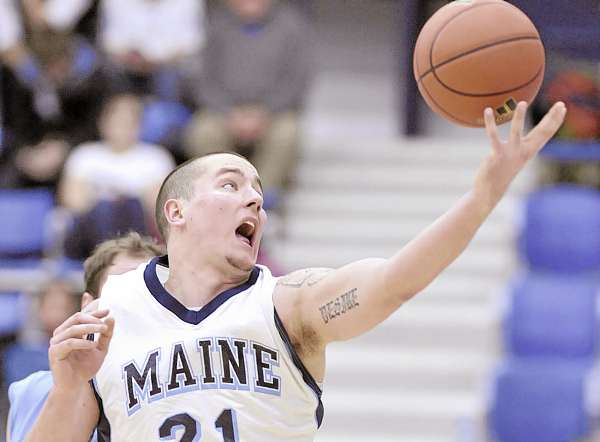 Maine's Sean McNally (21) collects an inbound pass under the bucket during the second half of their game against Columbia in Orono, Thursday, Dec. 30, 2010. Bangor Daily News/Michael C.York