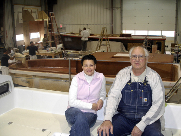 Belle Ryder and her father, Richard Ryder, sit in the cockpit of a Presto 30, which was built at their Union River Boat Co. in Bucksport, while crews from the shop work on the deck and hull for two other boats of the same design. The Presto 30 was recognized by SAIL Magazine recently as one of it top boats for 2011. BANGOR DAILY NEWS PHOTO BY RICH HEWITT