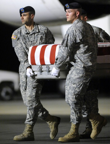 An Army carry team carries a transfer case containing the remains of Pvt. Buddy W. McLain Wednesday, Dec. 1, 2010 at Dover Air Force Base, Del. According to the Department of Defense, McLain, of Mexico, Maine, died while supporting Operation Enduring Freedom. (AP Photo/Steve Ruark)