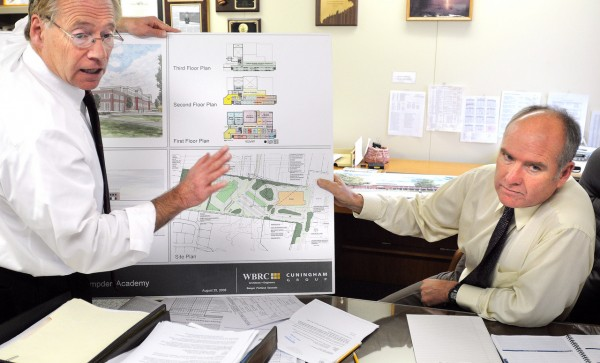 Richard Lyons the Superintendent of MSAD 22 (right) and Emil Genest the assistant Superintendent talk about the progress on the new Hampden Academy Building. (Bangor Daily News/Gabor Degre)
