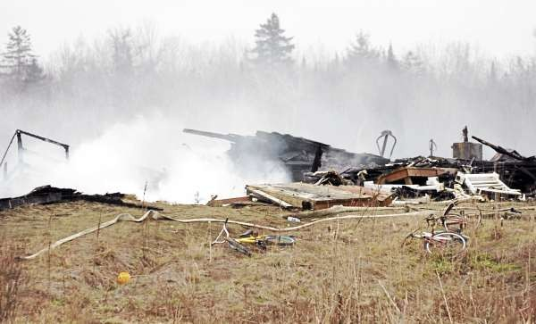The smouldering remains of 344 West Corinth Road, the fomer residence of the Godin family is seem in this image taken on Friday, December 3, 2010. (Bangor Daily News/Kevin Bennett)