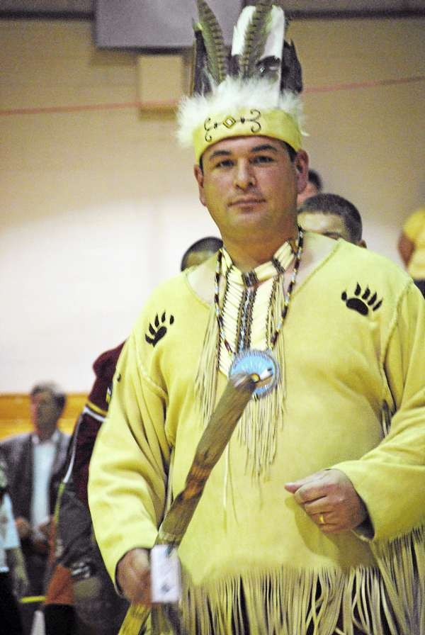 Newly inaugurated Passamaquoddy Tribal Governor Joseph Socobasin leads the Tribal Council and community members in a traditional dance Friday, Dec. 3, 2010.