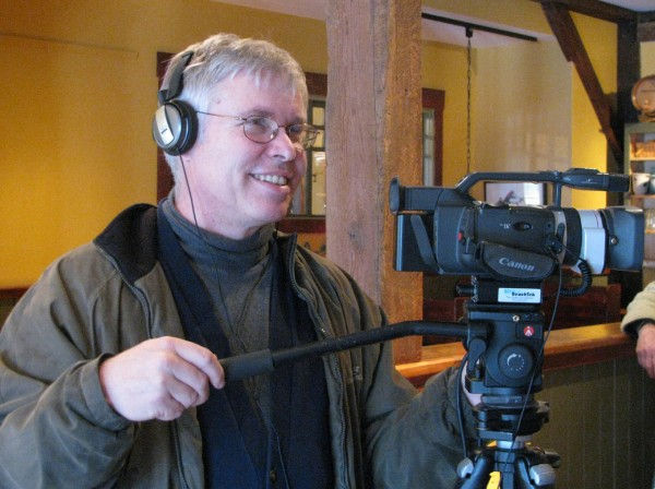 Ned Lightner of Belfast Community Television shoots some video at Darby's Restaurant in Belfast for a holiday shopping special for the TV channel. (Abigail Curtis/Beacon).