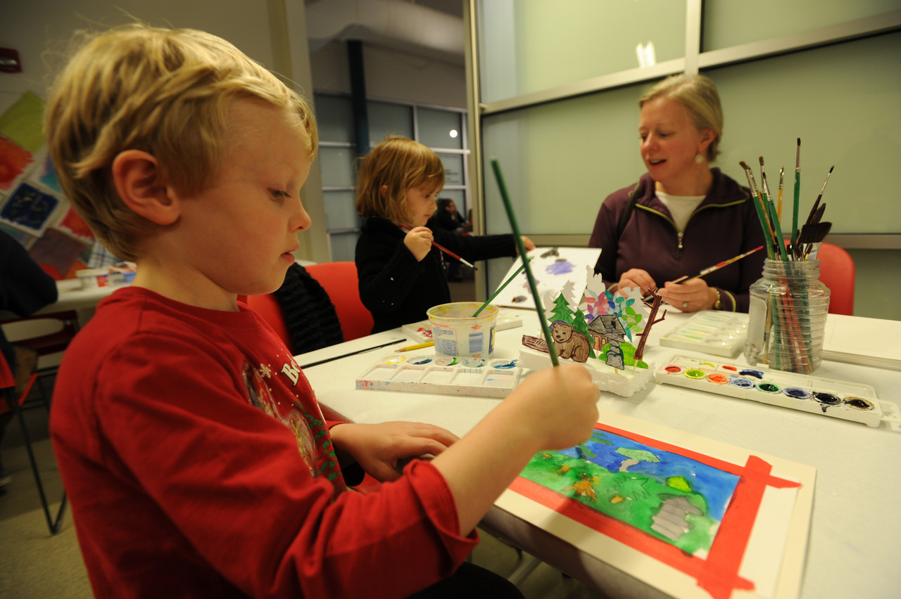 Gabriel Schmick (6), left, of Eddington and his sister Genevieve (3), center, along with their mother Jean participate in the Art Factory at the UMaine Museum of Art in downtown Bangor on Saturday, December  4, 2010. Children and adults utilized different work stations and received help from museum volunteers in creating works of art to be used to decorate for the holidays or to give as holiday gifts. (Bangor Daily News/Kevin Bennett)