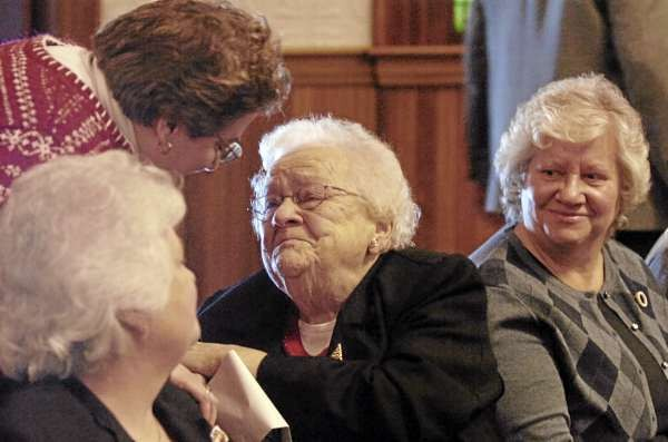 The Rev. Michele Cyr (cq) greets Gloria Lutterell, center, of Milo and of several Lutterell's daughters, including Jayne Sharrow (cq), left, of Dover-Foxcroft and Lutterell's stepdaughter Barbara Farrar, right of Brownville before the start of Sunday's service at Park Street United Methodist Church in Milo. On Sunday members of the church worshipped in their sanctuary for the first time since a fire damaged the church in June 2009. (Bangor Daily News/John Clarke Russ)