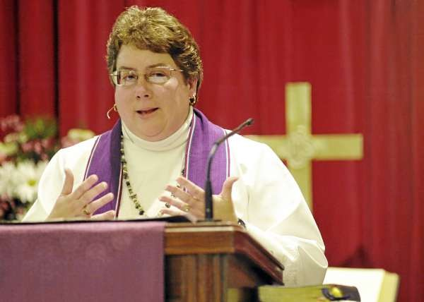 The Rev. Michele Cyr (cq) addresses the congregation during Sunday's service at Park Street United Methodist Church in Milo. On Sunday members of the church worshipped in their sanctuary for the first time since a fire damaged the church in June 2009. (Bangor Daily News/John Clarke Russ)