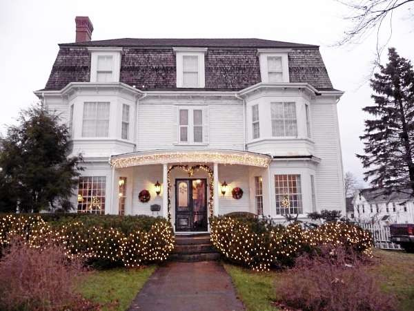 The exterior of the historic Hayden House in Eastport provides a glimpse of the stunning interior, which has been decorated for Christmas. The Eastport Chamber of Commerce hosted a historic home tour Saturday and Sunday, Dec. 4 and 5, 2010, which was enjoyed by hundreds. The 1805 Hayden House, where a ball was once held to commemorate the ending of the War of 1812, is now owned by Sidney and Richard Hungerford. It contains 17 rooms, including a music room, a formal parlor, a butlers' pantry, and a bathroom with a claw foot tub in the center of the room overhung by a crystal chandelier.
