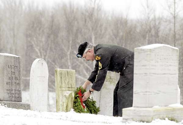 HERMON, ME -- DECEMBER 5, 2010 -- SFC(R) Thomas Copeland, JROTC Army Instructor at Hermon High School, lays wreaths on on the graves of veterans at Snows Corner Cemetery in Hermon on Sunday.  Copeland and several other volunteers placed about 330 wreaths at the five Hermon cemeteries following a Wreaths Across America Ceremony at Hermon Elementary School.  In 1992, Morrill Worcester, owner of Worcester Wreath in Harrington, Maine, had extra wreaths near the end of the holiday season.  Those wreaths were placed in one of the older sections of Arlington National Cemetery,  which started Wreaths Across America.  Every year since, Worcester has donated wreaths to Arlington National Cemetery to honor our fallen heroes.  LINDA COAN O'KRESIK
