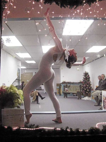 Alexandra Pitre danced in a storefront window as part of An Old Fashioned Belfast Christmas on Saturday, December 4, 2010. Pitre and others entertained passerby in the window of the former Waldo County Democrats headquarters on Main Street and will be there on upcoming Saturdays until Christmas as well. (Bangor Daily News/Abigail Curtis)