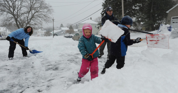 The Talon family of Old Town, left to right, Marion, Abbey, Mike and Gabe shovel the family driveway on Monday, December 6, 2010. Work for Marion and Mike was canceled due to the snow, allowing for a snow sledding adventure after the driveway was cleared of snow. (Bangor Daily News/Kevin Bennett)
