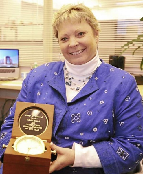 Penny Reckards proudly holds her &quot Outstanding Judicial Employee of the Year &quot award at her office in the Penobscot Judicial Center in Bangor on Monday, December 6, 2010. (Bangor Daily News/Kevin Bennett)