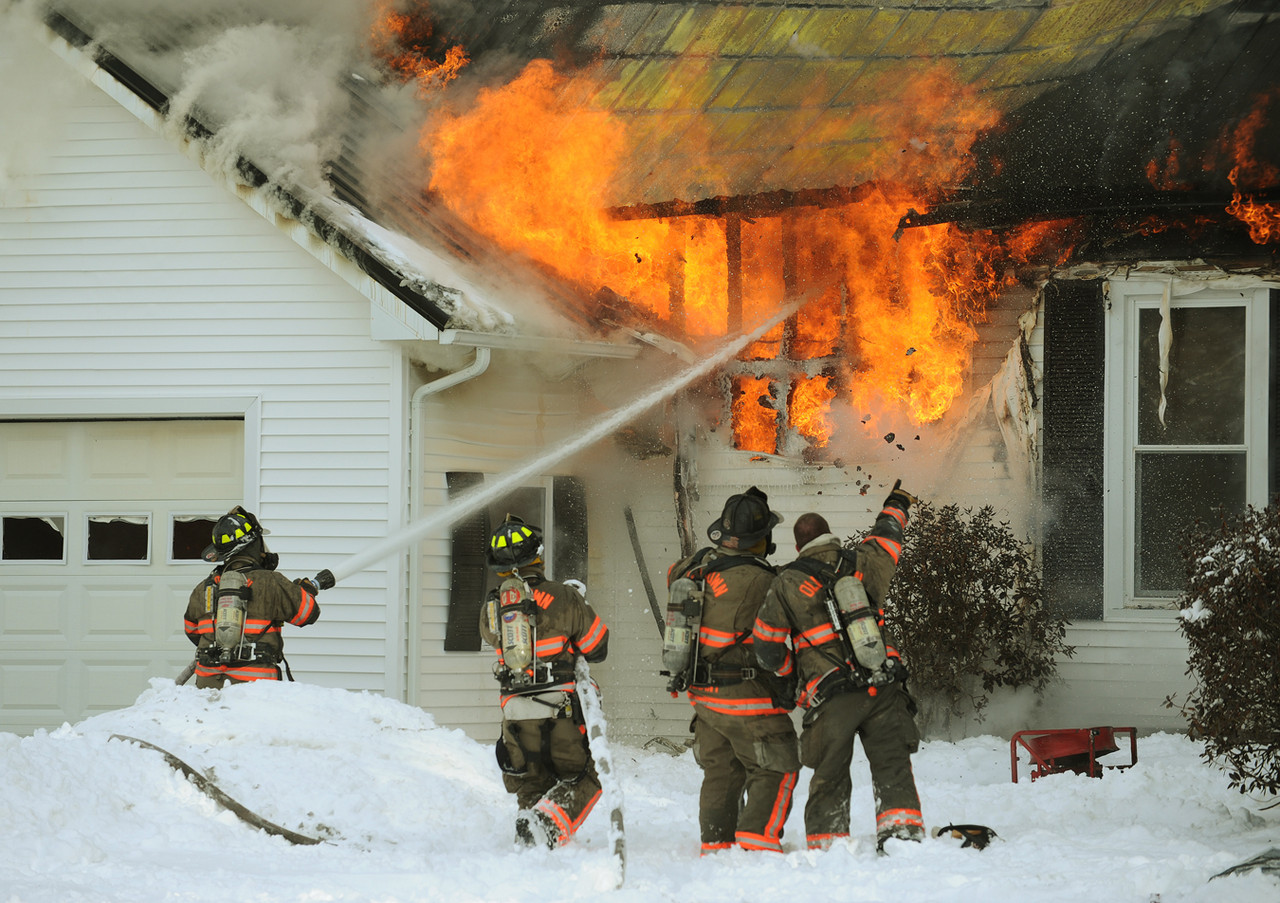 Old Town firefighters attack a house fire at 1023 Southgate Road in Argyle on Tuesday morning, December 7, 2010.  A two-story home and attached garage were a total loss according to the Argyle Deputy Fire Chief.  The fire was reported around 9:30a.m. by a passer-by. Fire departments from Argyle, Alton, Hudson, LaGrange and Old Town responded to the fire call. (Bangor Daily News/Kevin Bennett