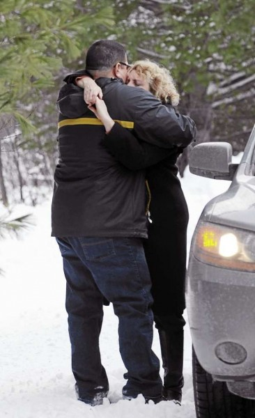 (BANGOR DAILY NEWS PHOTO BY KEVIN BENNETT)  CAPTION  Danny Valenzuela and Traci Tenggren embrace at the scene of a house fire at at 1023 Southgate Road in Argyle on Tuesday, December 7, 2010. Both lived in the home with several pets. Valenzuela fears the fire originated from a woodstove. (Bangor Daily News/Kevin Bennett)
