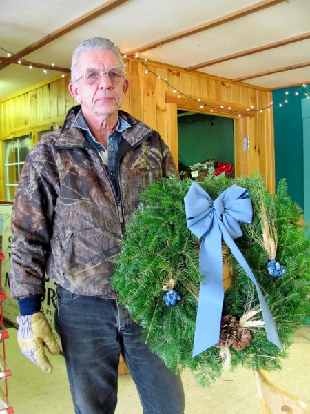 Ambrose &quotTom&quot McCarthy Jr. of Skowhegan, owner of Central Maine Wreath, displays one of the company's most popular products, the &quotBlue Royal Wreath,&quot in this December 7, 2010 photo. (Bangor Daily News/Christopher Cousins)