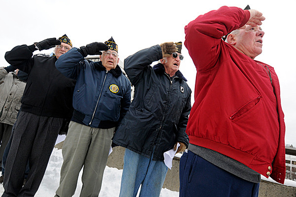 (BANGOR DAILY NEWS PHOTO BY JOHN CLARKE RUSS)CAPTIONFrom right: Bob Gaff of Bucksport, Ray Lane of Surry, Oliva Jacques (cq) of Bucksport joined other dignitaries in saluting the U.S. flag  during the playing of the National Anthem at Bangor's Pearl Harbor Remembrance Day ceremony on the Kenduskeag Stream footbridge at noon Tuesday. (Bangor Daily News/John Clarke Russ)