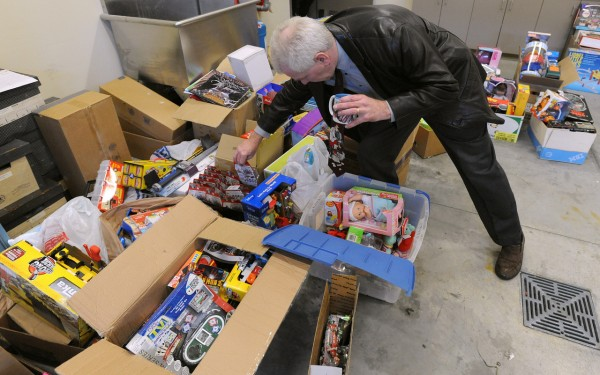 Bangor police Detective Tim Reid looks through some of the stolen toys that were recovered from a Patten Street home Wedensday, Dec. 8, 2010.  The toys were allegedly stolen from the Toys for Tots program by a person who volunteers there and who was selling them on the internet.  The value of the toys  will be be determined over the next day or two and early next week they will be returned to the Toys for Tots program.  Police will try to find out if the theft happened over a several-year period and it is expected that at least one person will be charged. (Bangor Daily News/Gabor Degre)