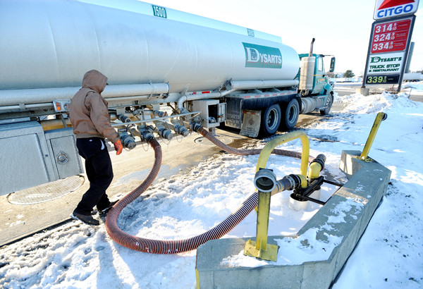 A tank truck driver (who wished to remain unidentified) unloads fuel at Dysart's in Hermon on Thursday, December 9, 2010. His load, weighing 90,000 pounds, came up Interstate 95 from Massachusetts.  A pilot program authored by Senator Susan Collins that allows trucks up to 100,000 pounds to travel on the interstate north of Augusta will expire on December 17, with little hope of an extension or being made permanent. (Bangor Daily News/Kevin Bennett)
