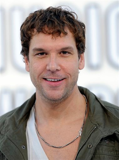 FILE - In this Sept. 12, 2010 file photo, Dane Cook arrives at the MTV Video Music Awards in Los Angeles.  The Massachusetts attorney general's office has ordered comedian Dane Cook's half brother and sister-in-law to pay $12 million in restitution after they pleaded guilty to stealing from him. (AP Photo/Chris Pizzello, File)