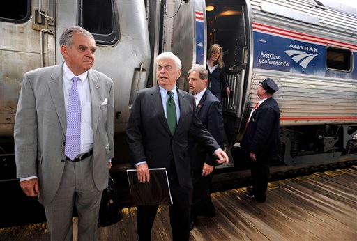 FILE - In this April 26, 2010 file photo, Transportation Secretary Ray LaHood, left, accompanied by. Sen. Christopher Dodd, second from left, get off an Amtrak train in Hartford, Conn. The Obama administration is taking $1.2 billion in high-speed rail money away from Ohio and Wisconsin and awarding it to other states, LaHood said Thursday. (AP Photo/Jessica Hill, File)