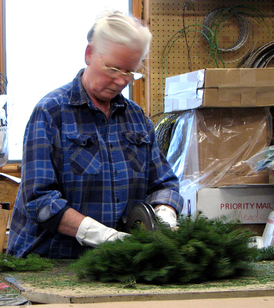 Judy Sherman, a wreath maker and the owner of Oxbow Wreaths in Oxbow, makes a  wreath at her business. Sherman is one of 30 foragers in northern Aroostook to  feature on a new website focusing on Maine?s culturally and economically  important wild plants and mushrooms. The site features profiles of the people  who use wild plants and mushrooms for food, medicine, crafts and more, detailed  descriptions of 30 plants including traditional and modern uses, and a  searchable database of more than 120 plants and mushrooms gathered in northern  Maine today. (PHOTO COURTESY OF MARLA EMERY) w/Lynds story