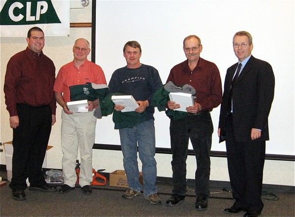 Three Maine logging professionals were honored during the annual Certified Logging Professional program's banquet Dec. 3, in Bangor. Presented with Logger of the Year awards were Duane Jordan (second from left), Supervisor/Contractor of the Year; Kurt Burrill (center), Conventional Logger of the Year; and John Ouellette (second from right), Mechanical Logger of the Year. On hand to present the awards were Justin Merrill (left) CLP board of directors vice chair, and Kenny Ferguson of Huber Resources.   PHOTO COURTESY OF CERTIFIED LOGGING PROFESSIONALS