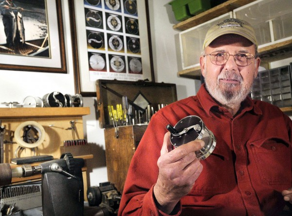 'Hobbyist' Paul Hermann and one of his traditional Atlantic Salmon fishing reels at his workshop in Castine , Maine, Thursday, Dec. 9, 2010. BangorDailyNews/Michael C. York