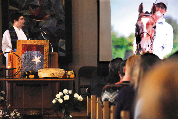 The Rev. Mark Glovin, left,  and and congregants watched a  memorial slide show  for Katrina Windred (pictured on right) during a celebration of her life at First Universalist Church in Rockland Saturday, Dec. 11.2010. The church was filled beyond capacity with family and friends who knew and loved Windred.(Bangor Daily News/John Clarke Russ)