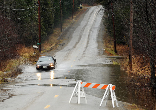 A motorist traverses a flooded seciton of the Levant Road in Kenduskeag on Monday, December 13, 2010. (Bangor Daily News/Kevin Bennett)