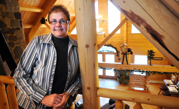 Lucy Cmber and her husband, Randy Comber, are the owners of Moosehead Cedar Log Homes in Greenville.  (BANGOR DAILY NEWS PHOTO BY GABOR DEGRE)