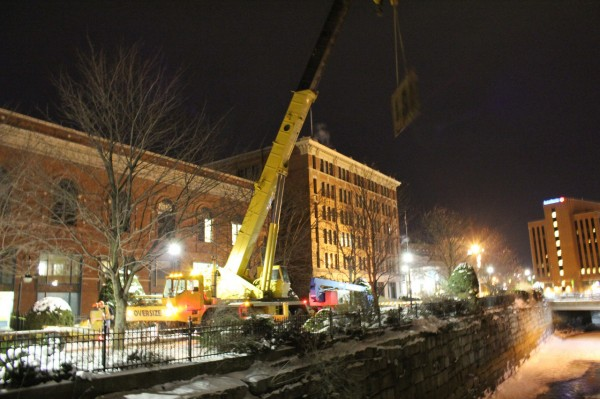 A crane from Thomas DiCenzo, Inc/DiCenzo Crane and Rigging at the site of a sinkhole in downtown Bangor on Friday, Dec. 10, 2010.  (Photo courtesy of Tony DelMonaco)