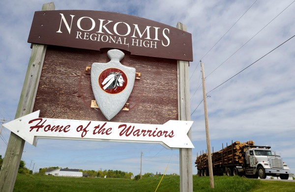 The Nokomis REgional HighSchool's sign in the median between Williams and Newport roads in Newport. &quotWe want to be respectful and dignified without having caricatures or undignified act,&quot said principal Mary Nadeau of the school's Native American image and &quotwarrior&quot nickname. &quotThis can provide a good teaching opportunity,&quot she added.  (BANGOR DAILY NEWS PHOTO BY JOHN CLARKE RUSS)