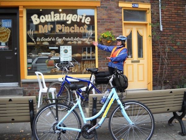 Montreal cycling guide Pam Crossen points out a typical Montreal neighborhood bakery. &quotAll you have to do is follow your nose to find good food in Montreal,&quot Crossen said. (Photo by Julia Bayly)
